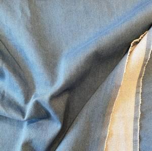 Bilde av Strikket stretch denim - lys blå